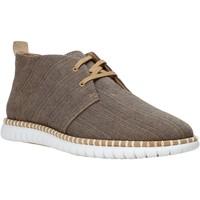 Boty Muži Kotníkové boty Clarks 26133529 Hnědý