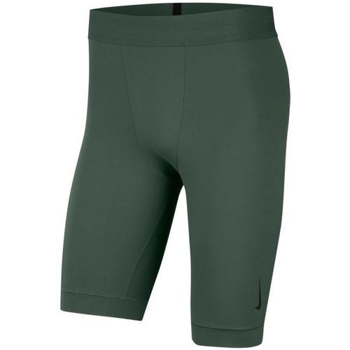 Textil Muži Kraťasy / Bermudy Nike Yoga Drifit Zelené